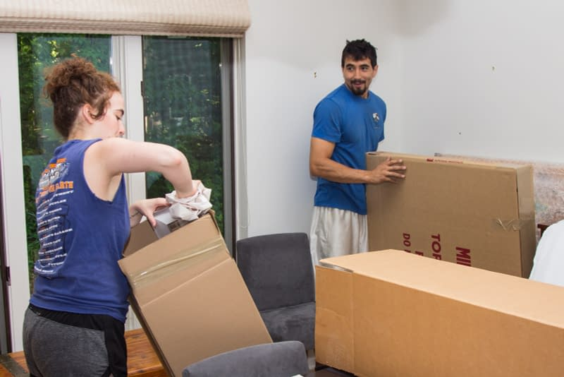 Spine movers unpackage boxes in new home