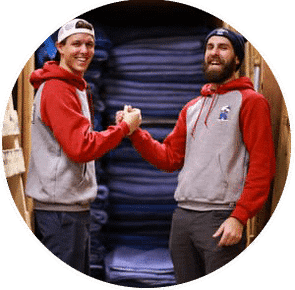 two movers shaking up and smiling