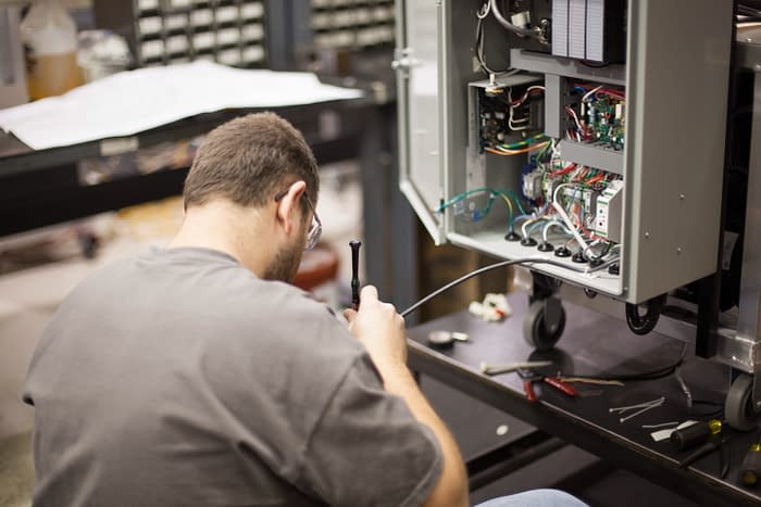 electrician works on wiring