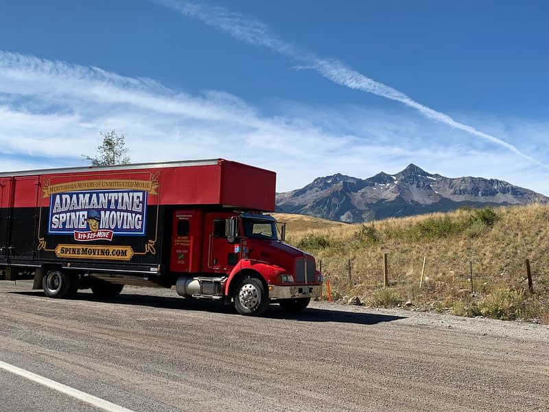 moving truck with mountains in background