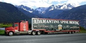 moving truck in front of mountain range