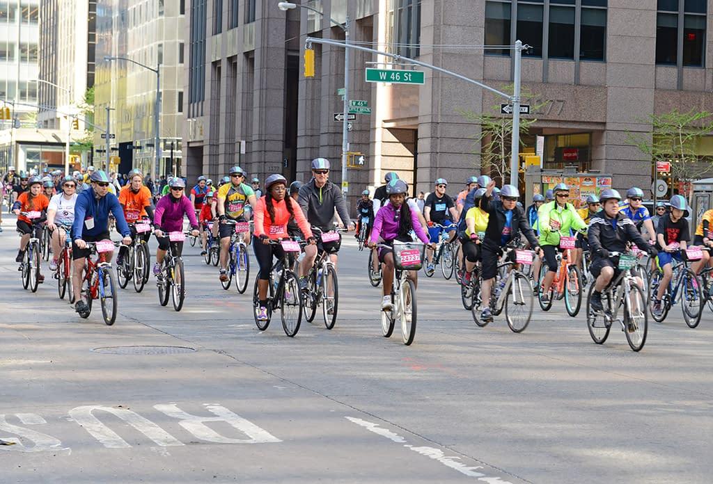 Cyclists On 6th Avenue Near In Midtown Near Rockefeller Center